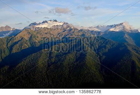 Sunrise Over Glacier Covered Mountains.  Mt Olympus, Olympic National Park, Washington.
