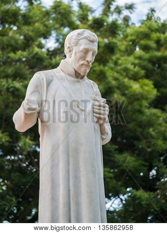 St. Francis Xavier statue in front of the ruins of St Paul's Church in Malacca Malaysia.
