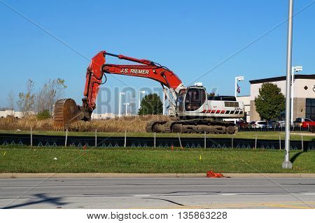 NAPERVILLE, ILLINOIS / UNITED STATES - NOVEMBER 3, 2015: A Link-Belt 330LX excavator, owned by J. S. Riemer Excavating Contractors, is ready to dig in Naperville.