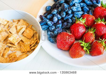 Healthy Breakfast. Corn Flakes With Ripe Red Strawberry And Blue Honeysuckle Berries.