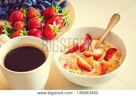 Healthy Breakfast. Corn Flakes With Ripe Red Strawberry, Blue Honeysuckle Berries And Cup Of Coffee.