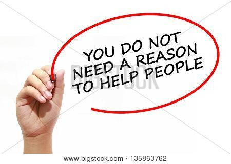 Man writing YOU DO NOT NEED A REASON TO HELP PEOPLE with marker on transparent wipe board.