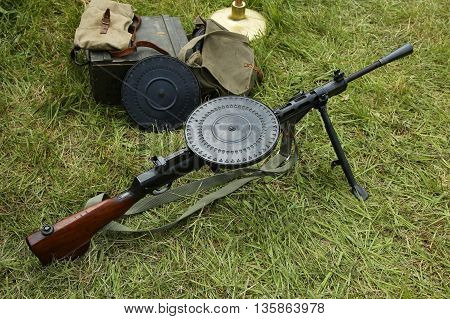 OLD BETHPAGE, NEW YORK - MAY 22, 2016: World War II Soviet Army military memorabilia with Degtyaryov machine gun on display during World War II encampment in Old Bethpage, NY