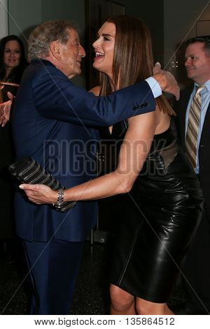 NEW YORK-MAR 30: Model Brooke Shields (R) hugs singer Tony Bennett at the