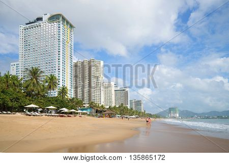 NHA TRANG, VIETNAM - DECEMBER 30, 2015: The city beach in the centre of Nha Trang. Big, the famous beach for tourists in Vietnam