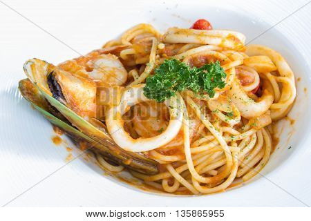 Seafood Spaghetti Thai Style on white dish