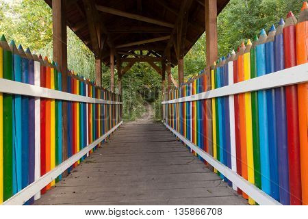 Photo of colorful pencil bridge on a sunny day