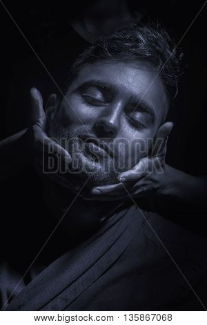 hands gentle touching man's headblack and white