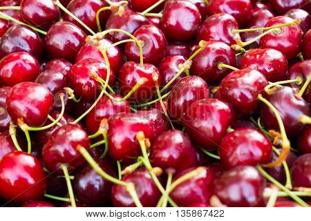 Large red cherry. Background of berries of cherry with water droplets. Beneficial dietary food. The gifts of nature vitamin. Delicious berries cherries.