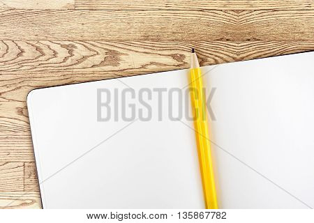 Open Notebook And Yellow Pencil On Wooden Table,top View, Template Mock Up For Adding Your Content