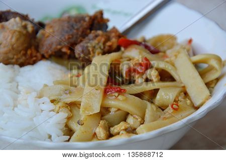 spicy bamboo shoot and deep fried chicken entrails on plain rice