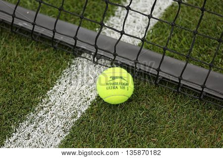 NEW YORK - JULY 21, 2015: Slazenger Wimbledon Tennis Ball on grass tennis court. Slazenger Wimbledon Tennis Ball exclusively used and endorsed by The Championships, Wimbledon