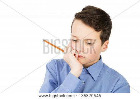 Pensive Schoolboy In Shirt With A Pencil Beside His Mouth Isolated On White