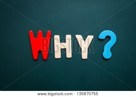 Text 'why' wording on blackboard - business concept of 5 WHs questions - problem solving - colorful alphabet made from wood