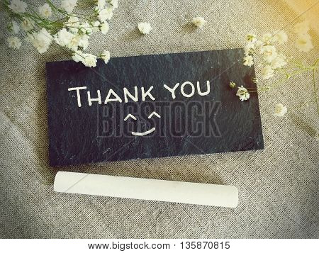 Blackboard for your text and flowers with word thank you