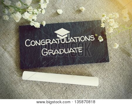 Blackboard for your text and flowers with words congrats graduate