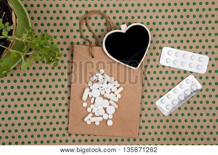 White Pills And Capsules, Handmade Shopping Bag, Gift Bag And Blank Blackboard In The Form Of Heart