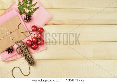 wood background table, envelope and cherry, invitation, flat lay