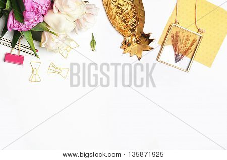 Mock up background woman desk. Gold pineapple flower. Flat lay. Accessories on the table view top desk top modern.