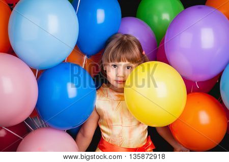 Studio Portrait Of Funny Little Caucasian Blond Girl