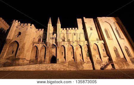 Popes' Palace of Avignon at night, unesco world heritage in Southern France
