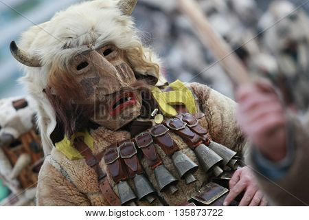 Pernik, Bulgaria - January 30, 2010: Unidentified man in traditional Kukeri costume are seen at the Festival of the Masquerade Games Surva in Pernik, Bulgaria.