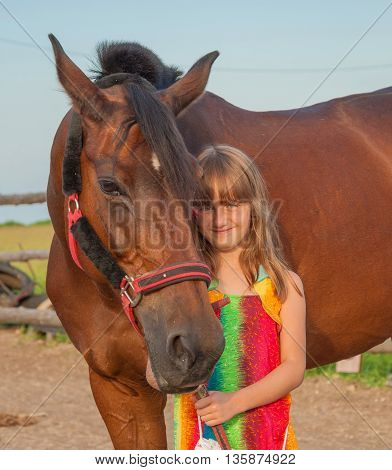 cute smiling little girl with a horse