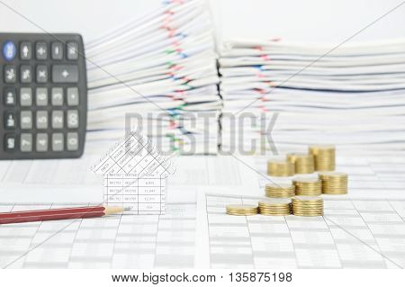 House And Brown Pencil With Step Pile Of Gold Coins