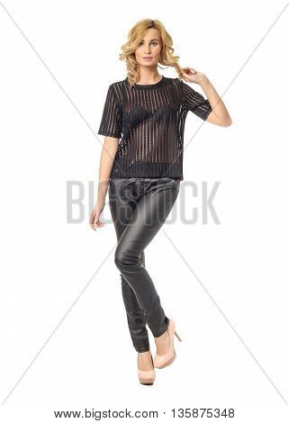 Beauty Blonde Woman In Tight Leather Pants Isolated