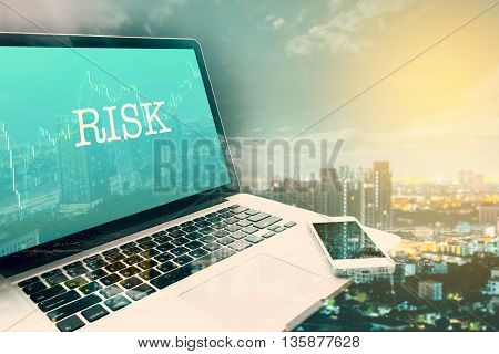 RISK : Green screen laptop computer. Double Exposure Vintage effects. Business and technology concept.