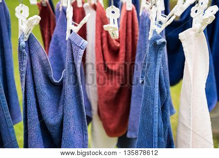 hanging washed blue brown towel on sunny day