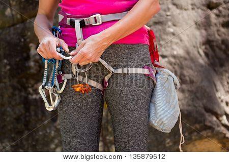 Close up climbing equipment on a woman