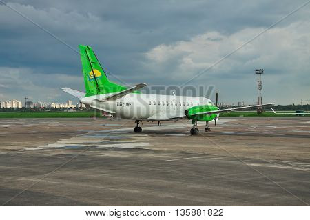 Kiev Ukraine - May 17 2012: South Airlines Saab 340B parked in front of the airport terminal