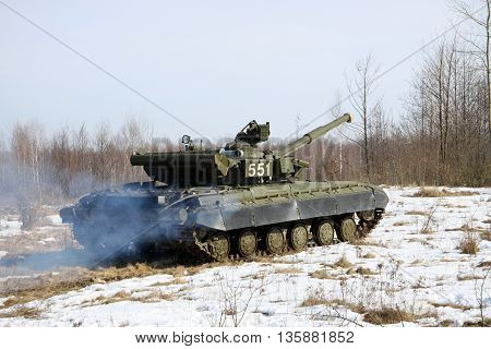 Zhitomir Region Ukraine - March 10 2011: Ukrainian Army main battle tank T-64BV during the training driving