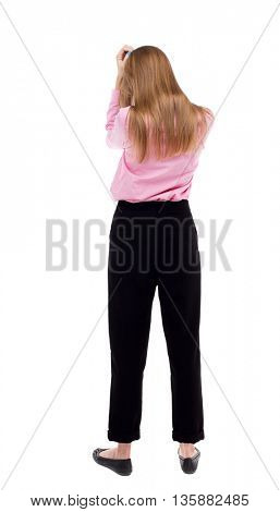 Back view of shocked woman. upset young girl. Rear view people collection.  backside view of person.  Isolated over white background. The girl office worker in black trousers is buried in his hands.