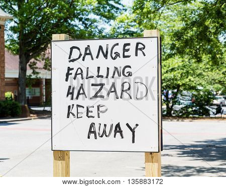 A Danger Falling Hazard sign hand painted