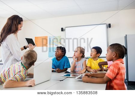 Pupils listening the teacher in classroom