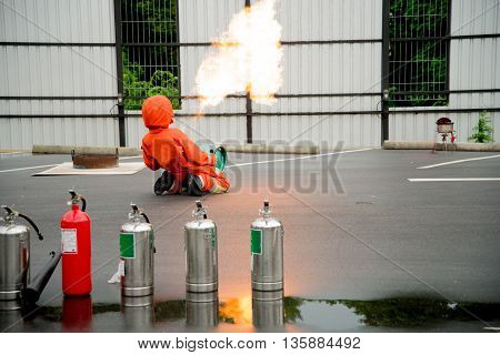 Firefighter fighting fire during training industry safety