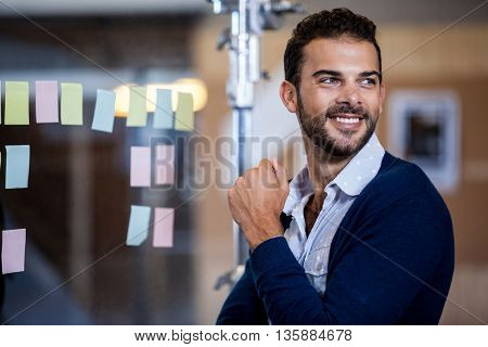 A young businessman looking away in office