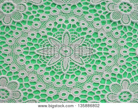 White mat crotch doilie over light green background