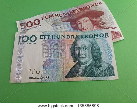 Swedish currency SEK from Sweden over green background