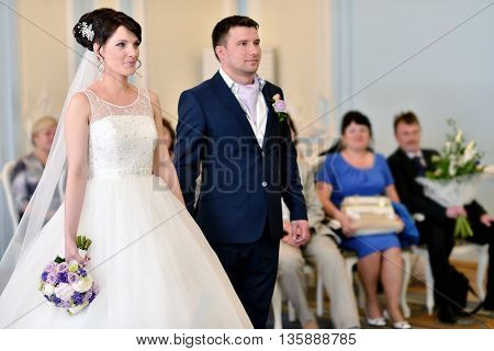 Beauty Bride And Handsome Groom Are Registering The Marriage. Wedding Couple Is Marrying. Beautiful