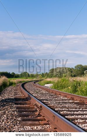 Train Tracks Curving Into The Distance