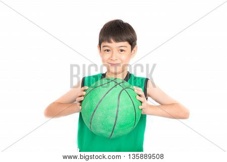 Little boy playing green basketball in green PE uniform sport with clipping path isolate on white background