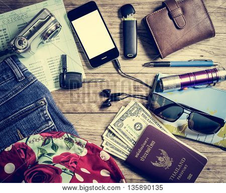 Set Of Travel Accessory On Wooden Table