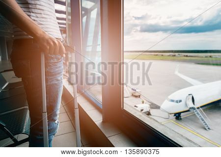 Woman With Her Baggage Waiting For Her Flight