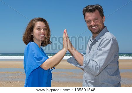 Cheerful Couple Looking At Camera Together At Summer Beach