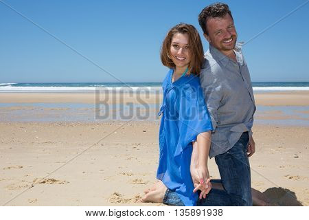 Happy And Cheerful Young Couple At The Beach