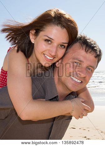Handsome Caucasian Man Having His Woman Piggyback On His Back