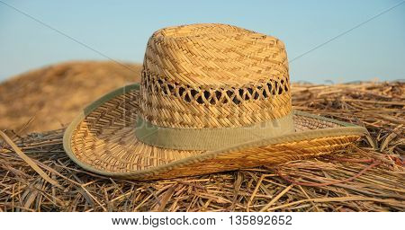 The straw hat lying on hay stack